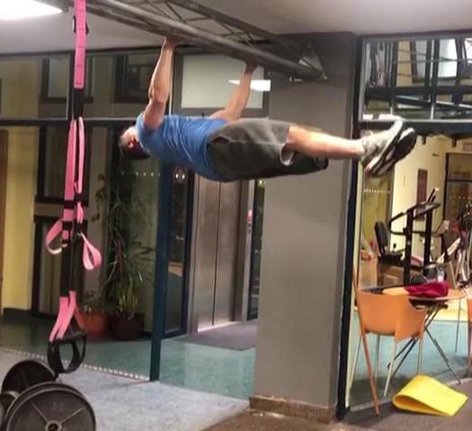 colin macgregor hanging from a bar horizontally